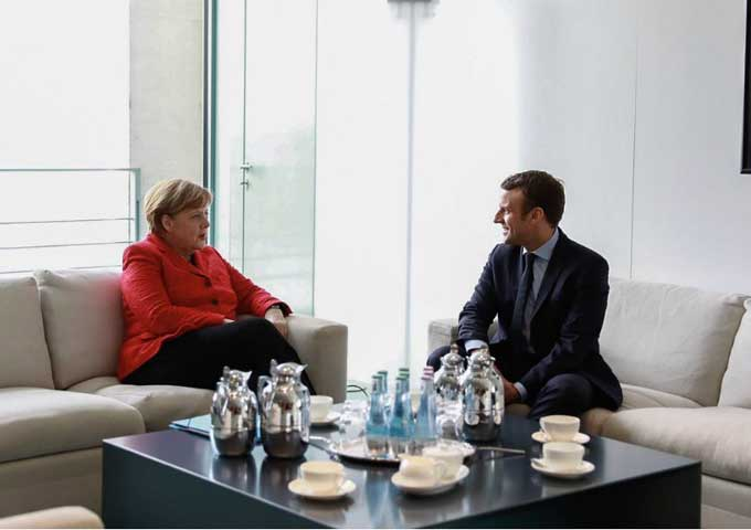 ماكرون يتحدث مع ميركل ويناقش خروج بريطانيا من الاتحاد الأوروبي مع تيريزا ماي