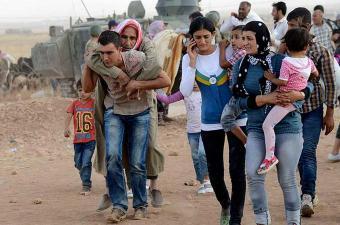 فرار الآلاف من هجوم عفرين والقوات السورية تمنعهم من الوصول إلى حلب
